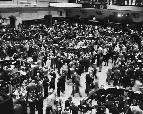 Crowds of traders on the New York Stock Exchange trading floor in 1955.