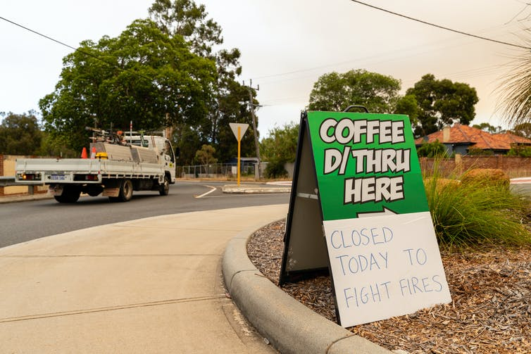 A drive-through coffee shop sign that reads 'closed today to fight fires'