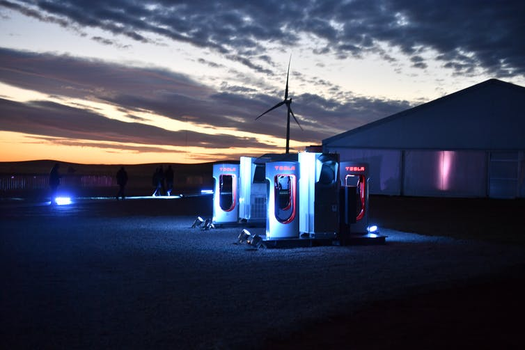 view of electric charging station at night