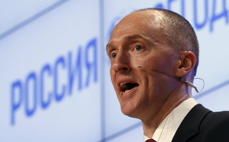 Head shot of Carter Page giving a speech with headset microphone.