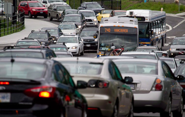 Motorists merge from four lanes into one as they enter the Lions Gate Bridge to drive into Vancouver.