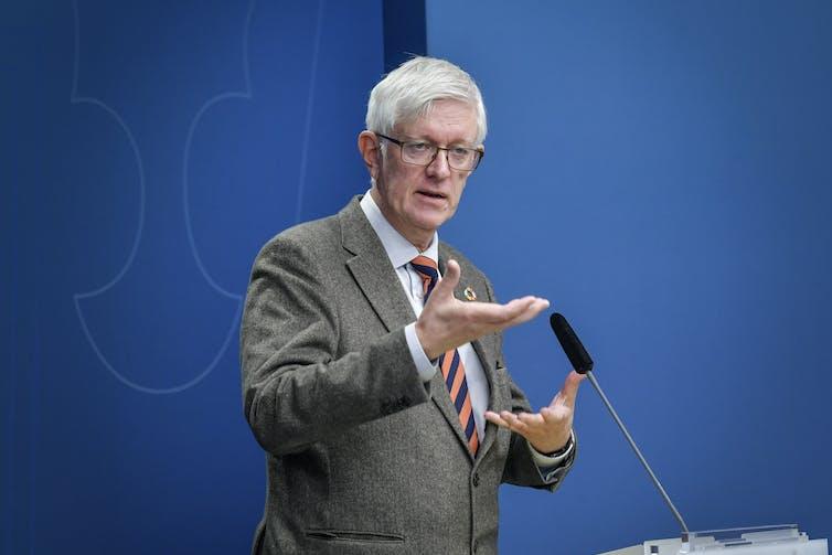 The head of Sweden's public health agency, Johan Carlsonm, giving a speech.