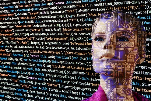 A woman's face is seen through a screen of code.