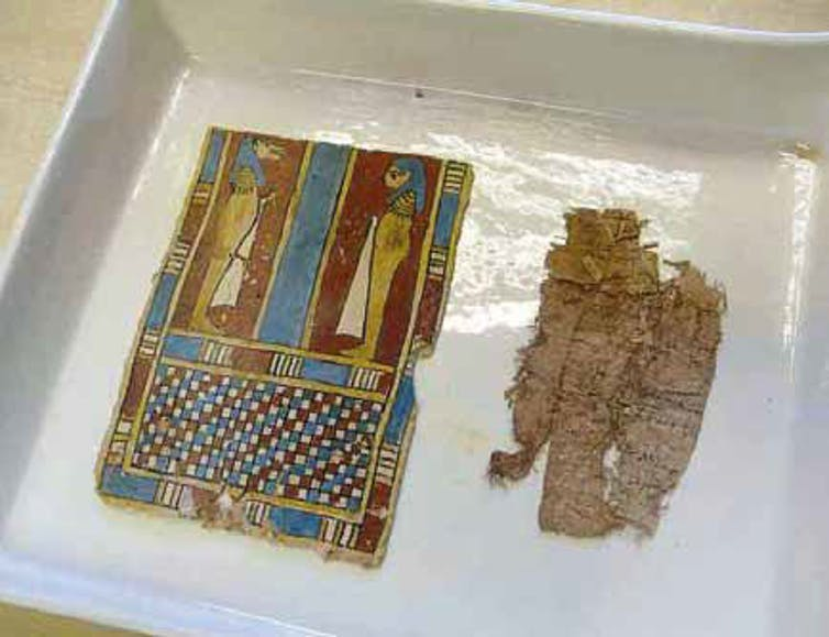 Artefacts shown in a flat container.