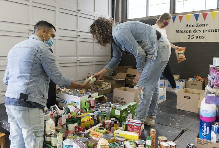 Volunteers sort through donated food items.