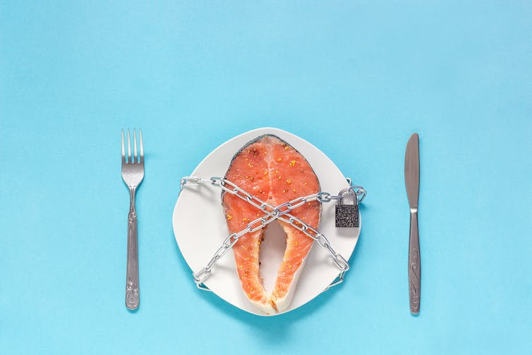 Salmon chained to a plate