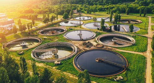 aerial view of sewage treatment plant at sunset