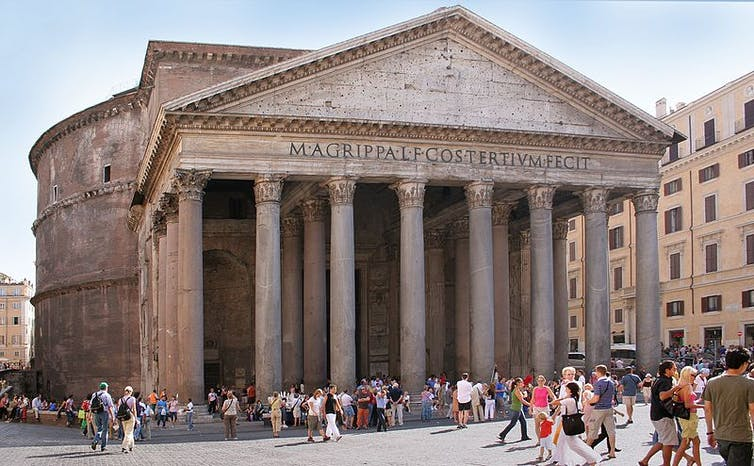 The Pantheon, n ancient building with columns and a dome, and a crowd in front of it