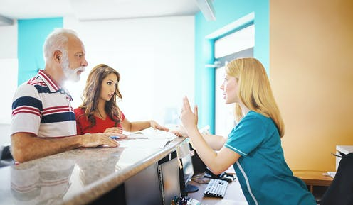 A patient talking to a health care worker.