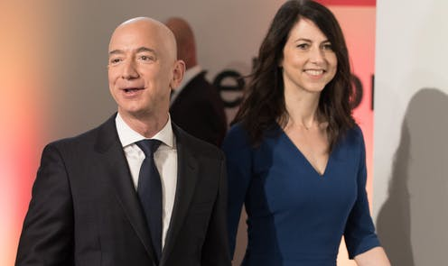 Jeff Bezos stands next to his ex-wife, MacKenzie Scott.and a tall woman.