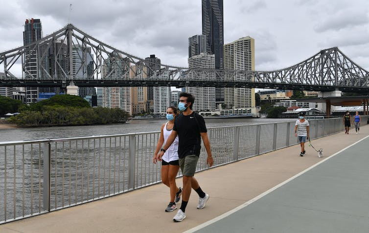 People walking in Brisbane wearing masks