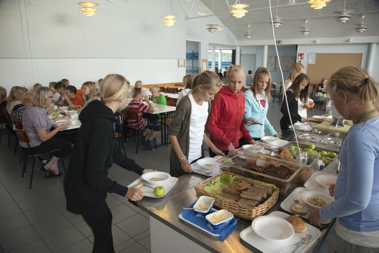 School children getting lunch in a canteen