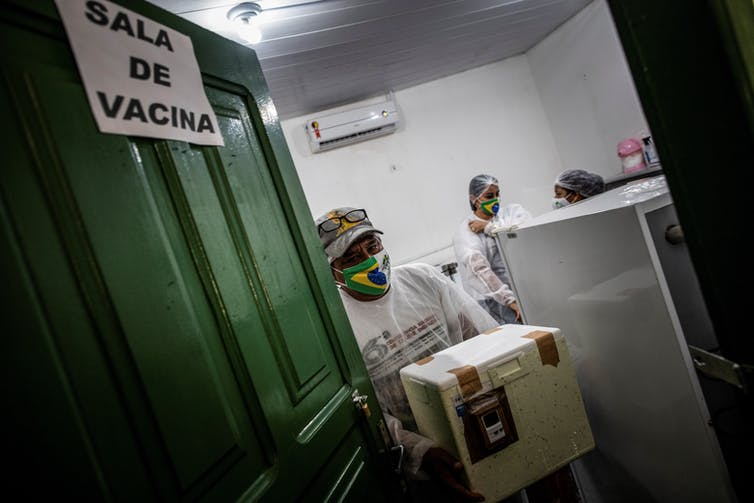 Health workers in Brazil involved with COVID vaccinations