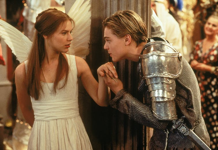 Juliet as an angel, Romeo as a knight. He goes to kiss her hand.