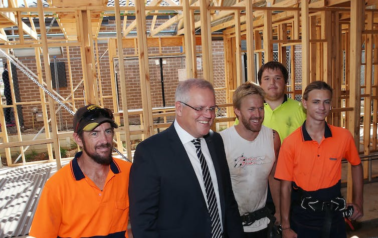 Prime Minister Scott Morrison and tradesmen on a home construction site