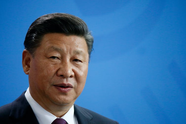 Xi Jinping against a blue background