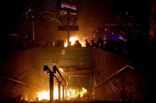 A metro station is set on fire during rioting in the Chilean capital Santiago in 2019.