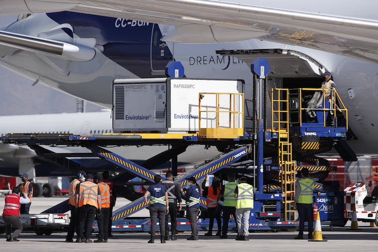 Sinovac COVID-19 vaccines being unloaded from a plane in Chile