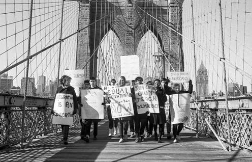 A group of activists call for the end of school segregation in New York City.