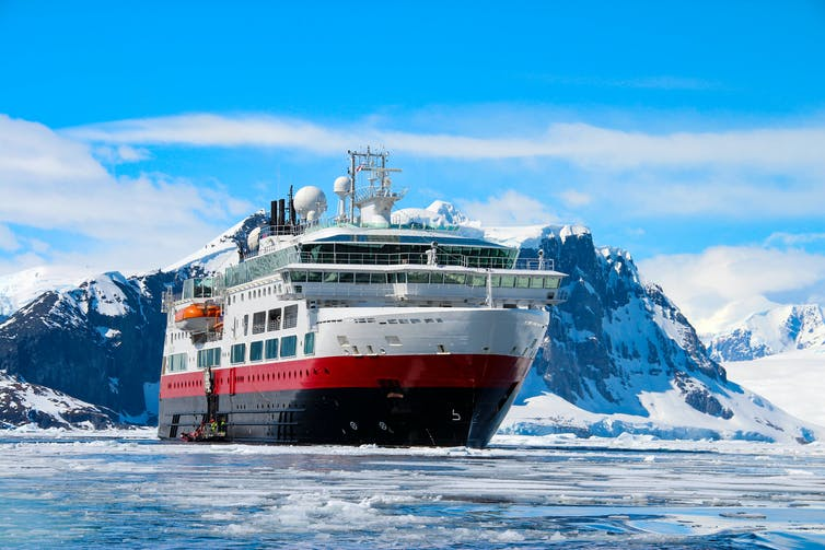 A huge cruise ship in icy Antarctic waters