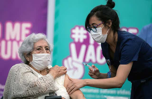 A nurse vaccinating a woman in Chile