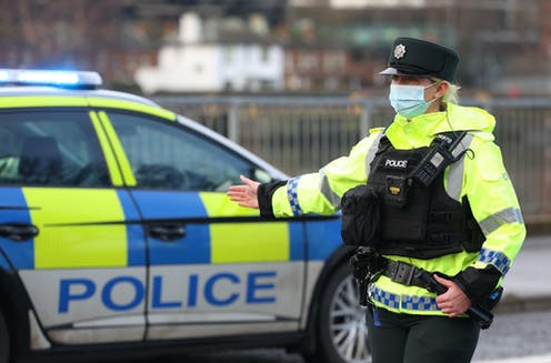 A police officer directing traffic in Belfast.
