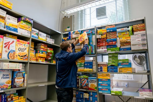 Man stacking cereal boxes on shelves