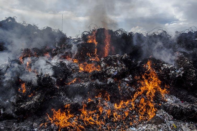Pile of plastic waste burning.