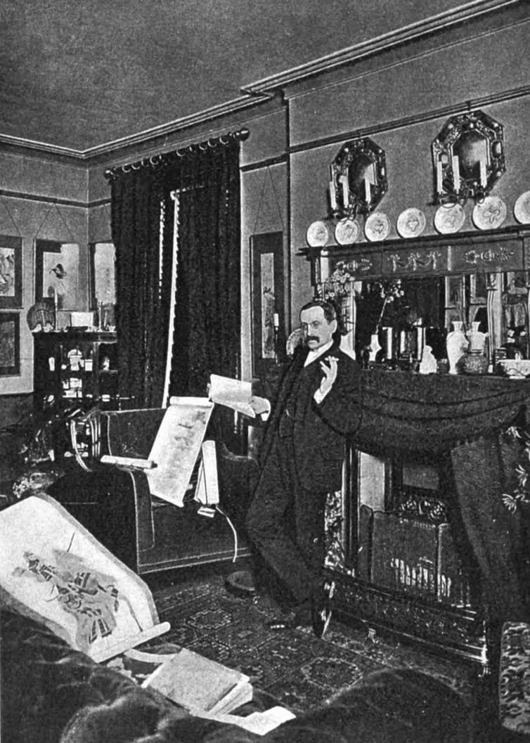 man in black and white photo in living room