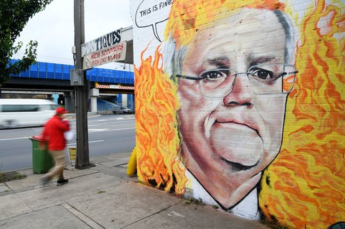 Mural of Scott Morrison surrounded by flames