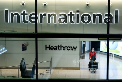 Passenger arriving at Heathrow Airport in London, England