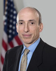 Gary Gensler portrait shot in front of US flag
