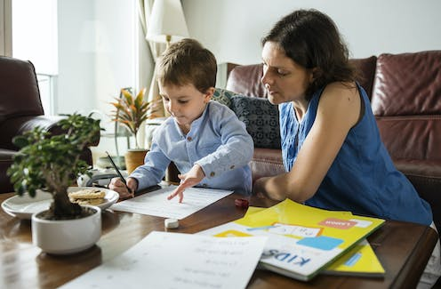Parent supervising child education at home