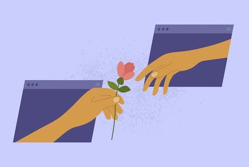 Two hands reaching through website windows.