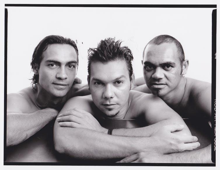 Photo portrait of three men.