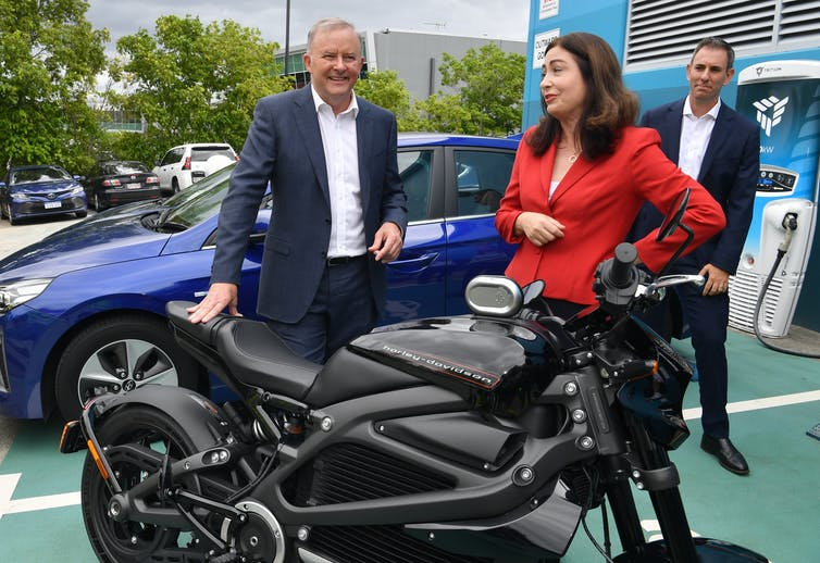 Anthony Albanese and Labor MPs Terri Butler and Jim Chalmers inspect a motorbike.