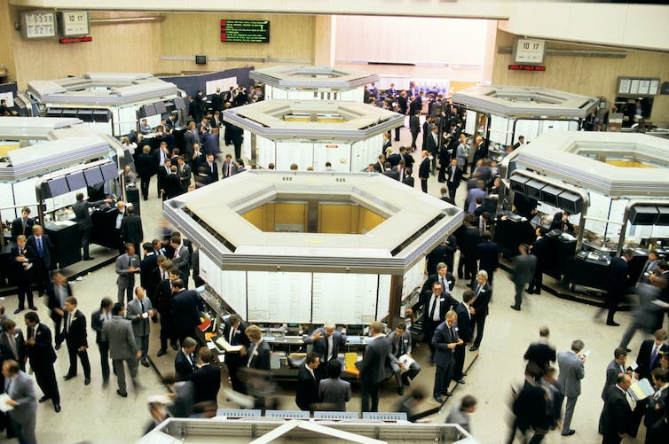Traders on the floor of the London Stock Exchange a few days before the Big Bang of 1986.