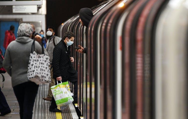 Commuters boarding a London Underground train