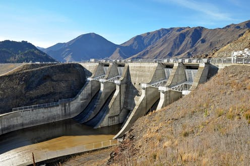 Dam spillway with mountains in background