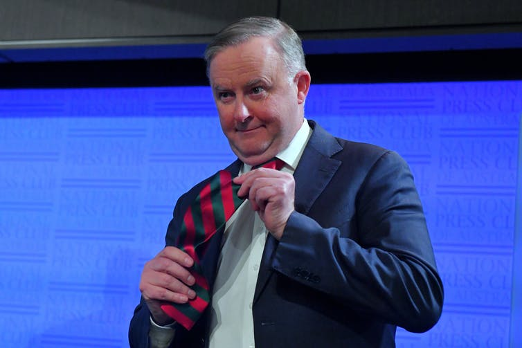 Anthony Albanese shows his red and blue necktie.