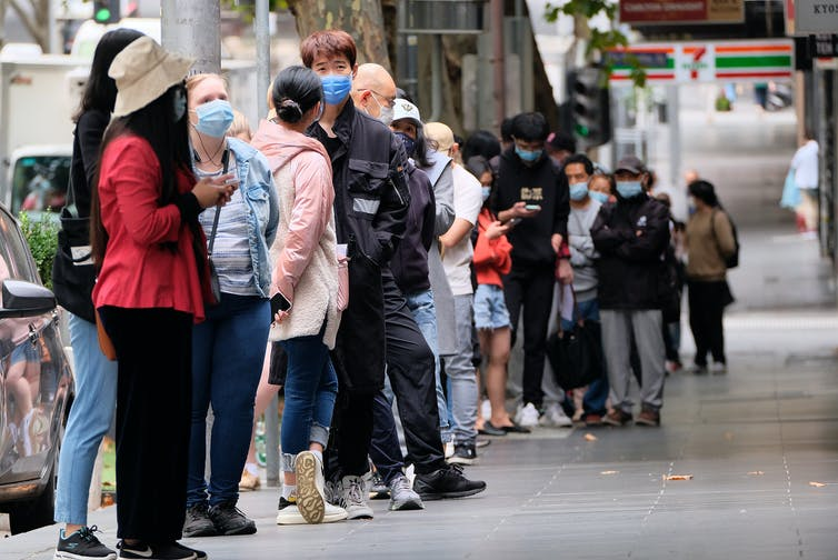 People queueing up in Melbourne to have a COVID test.
