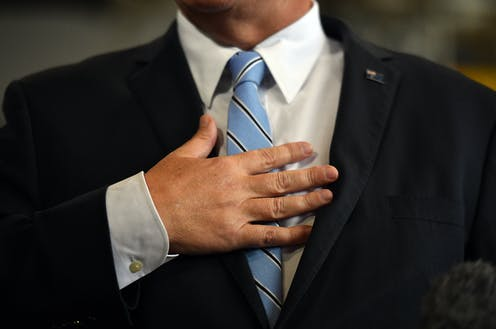 Man in suit with blue tie