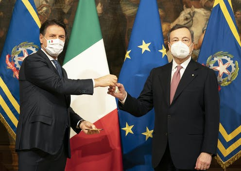 Giuseppe Conte and Mario Draghi are pictured at a ceremony to transfer power.