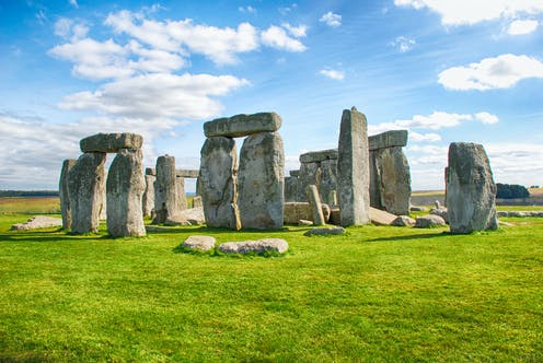 Stonehenge photographed against a blue sky
