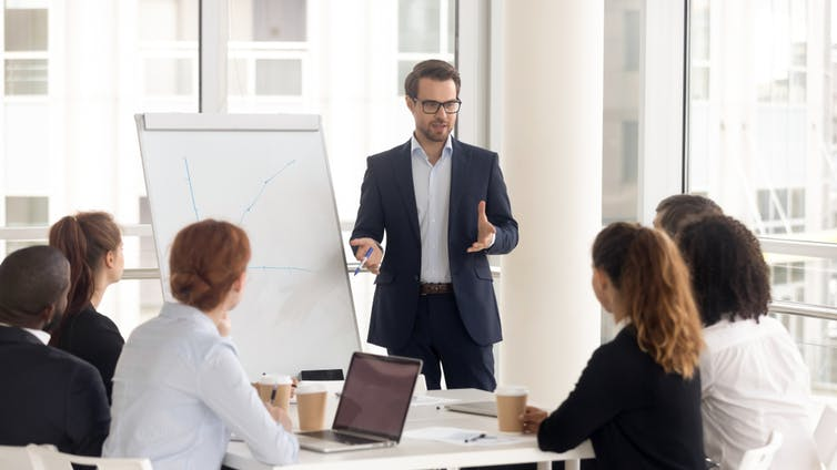 Consultant giving presentation to a small group in a meeting room