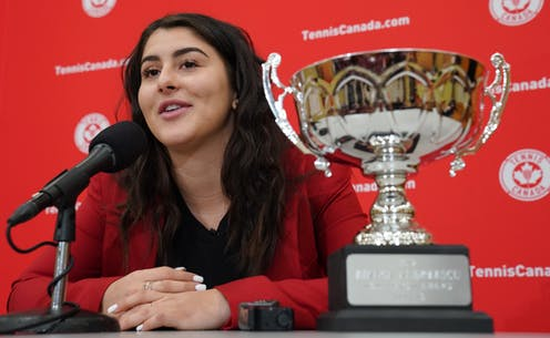 Bianca Andreescu at a microphone with the Lou Marsh