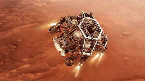 An artist's impression of NASA's Perseverance rover firing up its descent stage engines as it nears Mars's surface.
