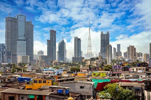 Slum in foreground, skyscrapers in background
