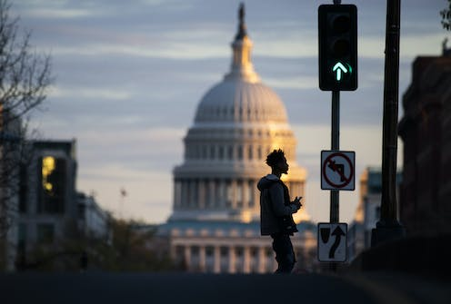 The Capitol dome, with a green traffic light in front of it