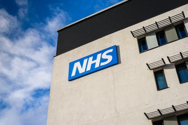 An NHS building bearing the NHS logo